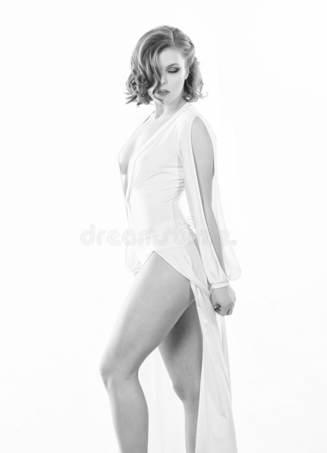 Attractive appearance concept. Girl confident model seductive posing on white background. Sexy seductive dress. Woman royalty free stock image