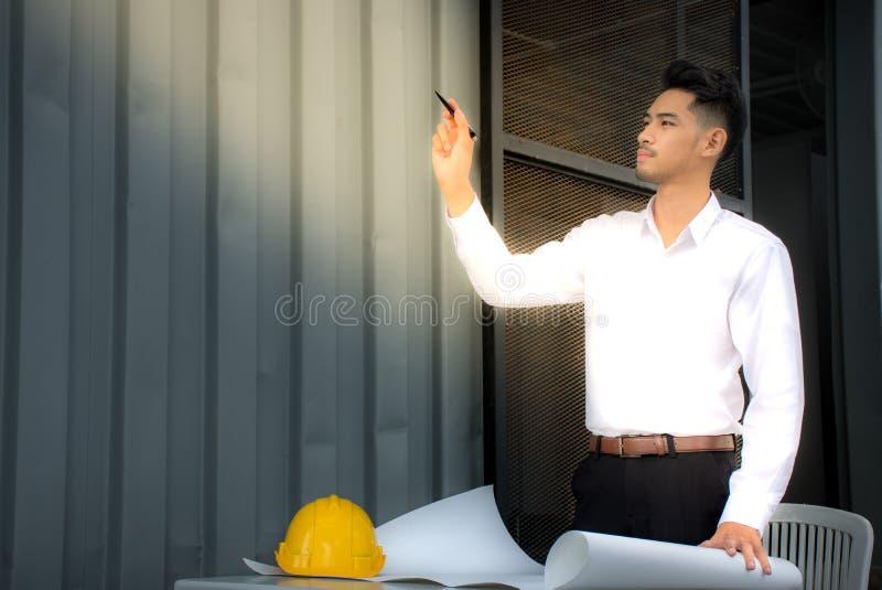 Attractive architect engineer thinking stock photo