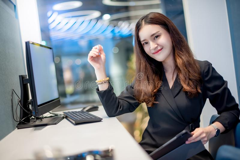 Attractive Asian businesswoman working in office royalty free stock image