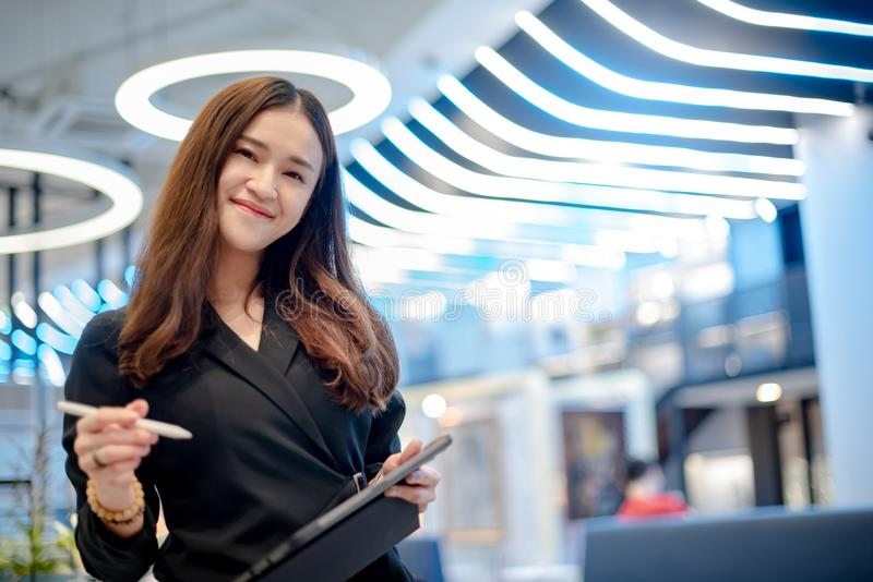 Attractive Asian businesswoman working in office royalty free stock photos