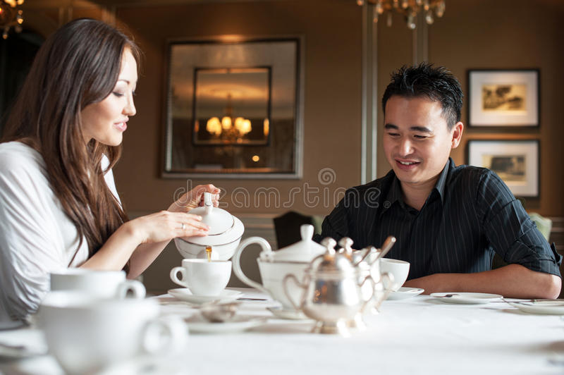 Attractive Asian couple in a cafe royalty free stock photo