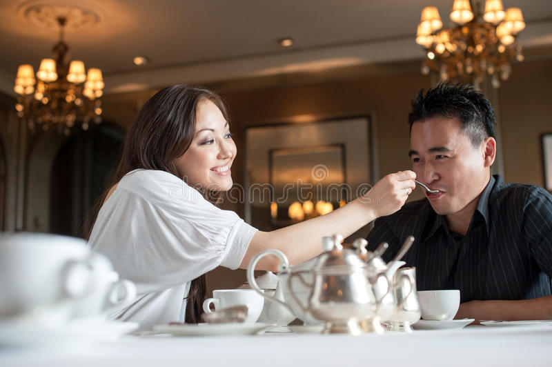 Attractive Asian couple in a cafe 4 stock photos