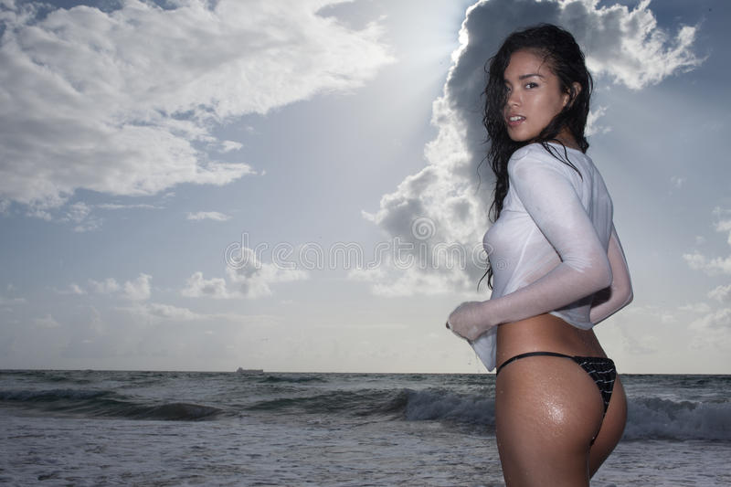 An attractive asian model on the beach on a sunny day stock image