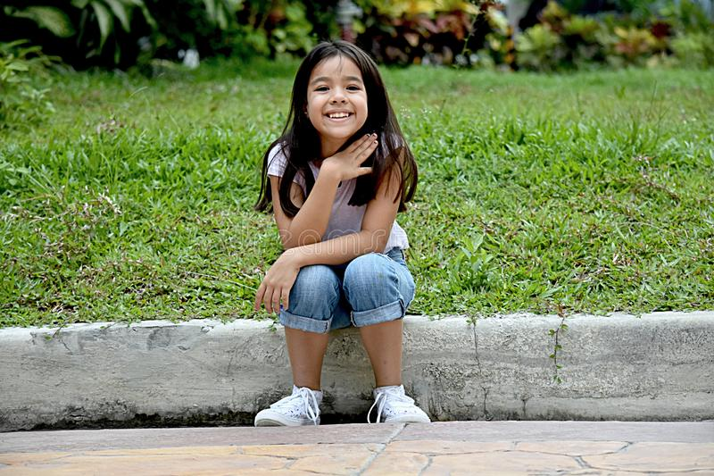 Appreciative Youthful Filipina Person. An attractive and asian person stock photography