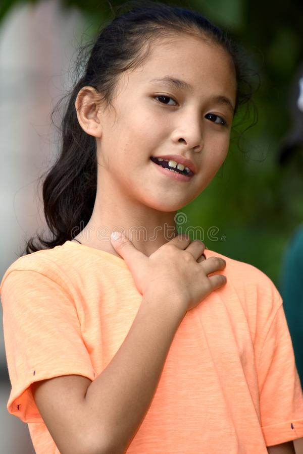 Appreciative Youthful Minority Girl. An attractive and asian person royalty free stock photos