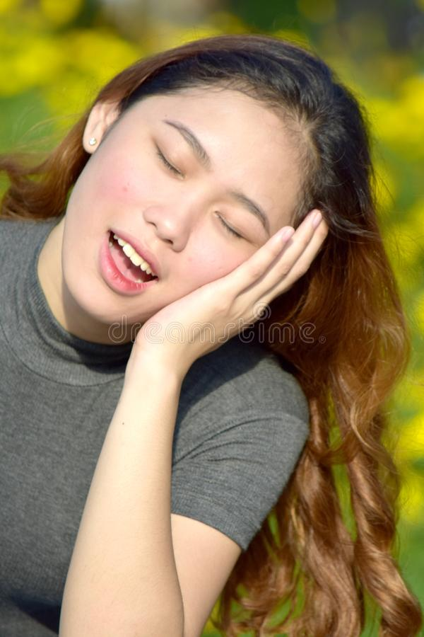 A Sleepy Female Woman. An attractive and asian person royalty free stock photography