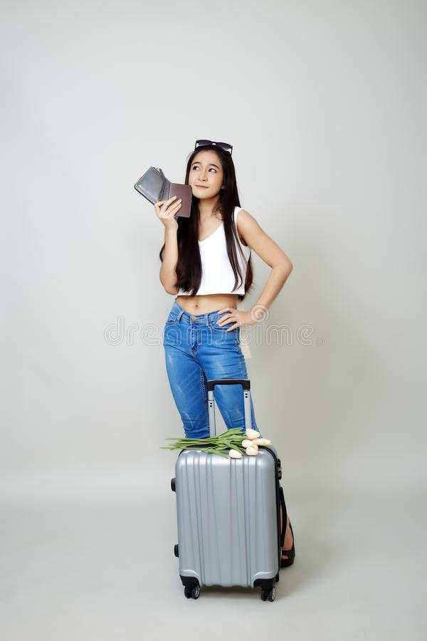 Attractive asian tourist woman with luggage stock images