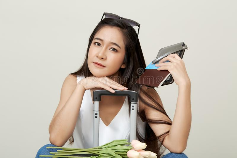 Attractive asian tourist woman with luggage royalty free stock images