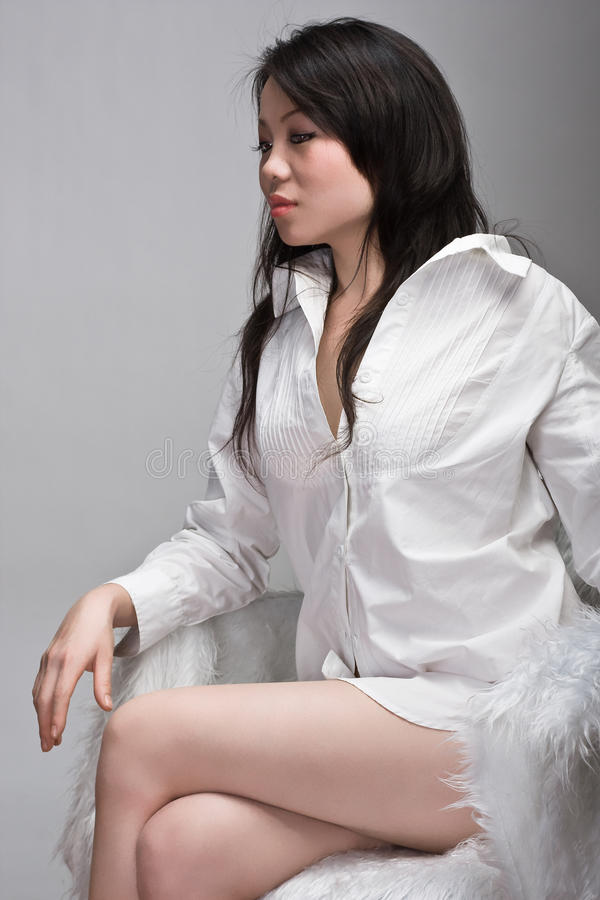 Download Attractive Asian Woman In Chair Stock Image - Image: 11978637