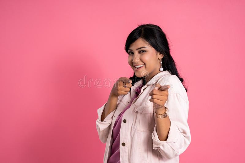Attractive asian woman pointing to camera royalty free stock photo