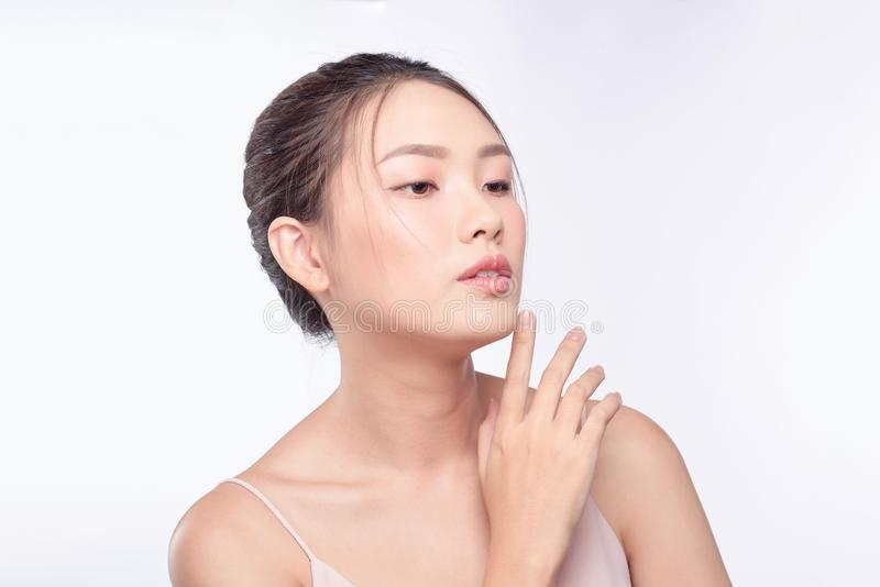 Attractive asian woman skin care image on white background.  stock photo