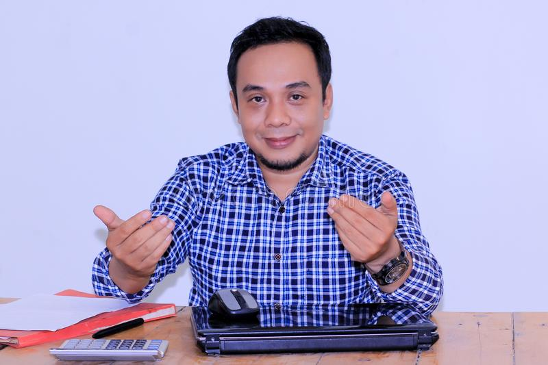 Attractive asian young bussinessman with hand gesture join with us royalty free stock photography