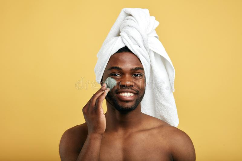 Attractive awesome man enjoys cosmetic procedure stock photos