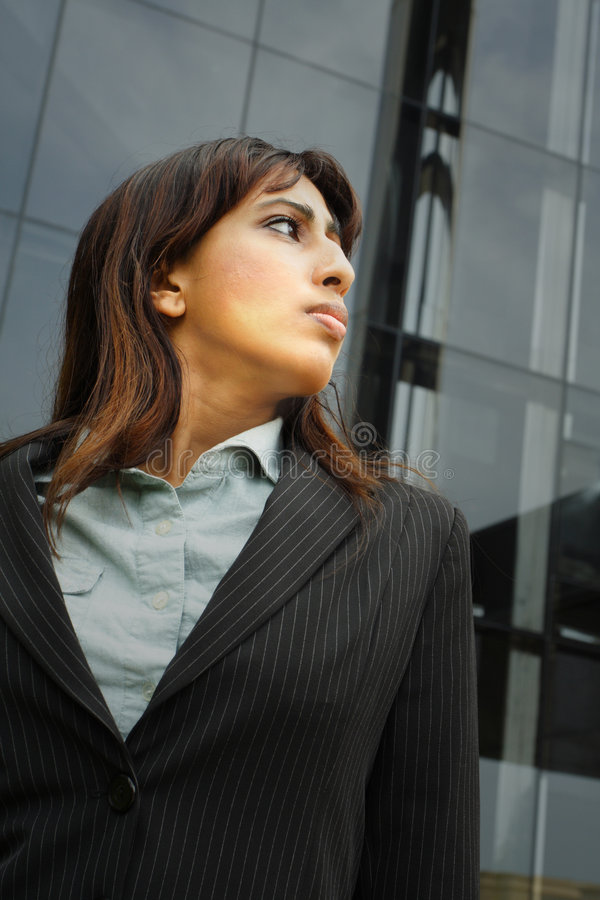 Attractive Bangladesh Female. Young Bangladesh Businesswoman glancing over her shoulder stock photos