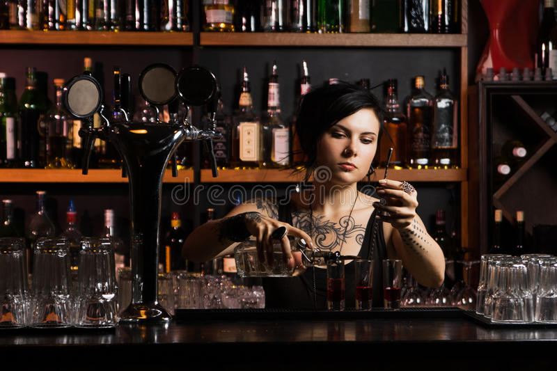 Attractive bartender stock images