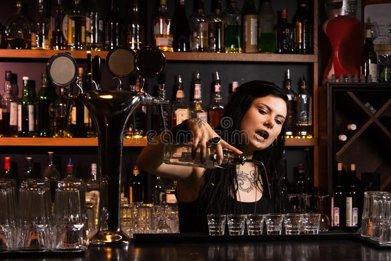 Attractive bartender stock image