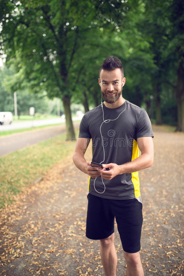 Attractive bearded man listening to music royalty free stock image