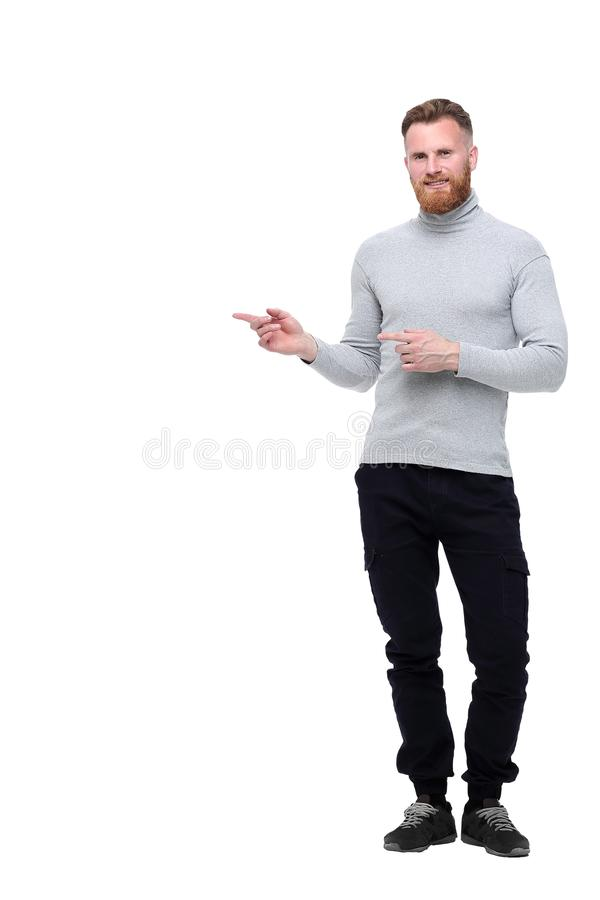 Attractive bearded man pointing somewhere to the side stock photography