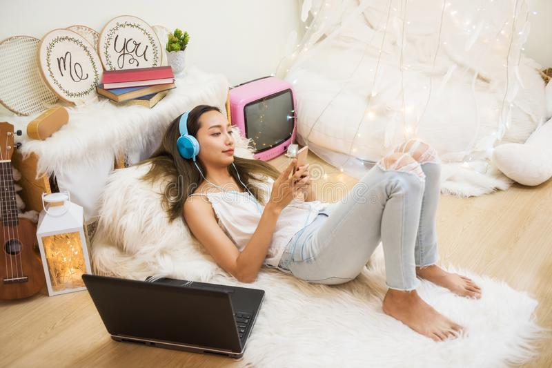 woman play smartphone in living room royalty free stock images