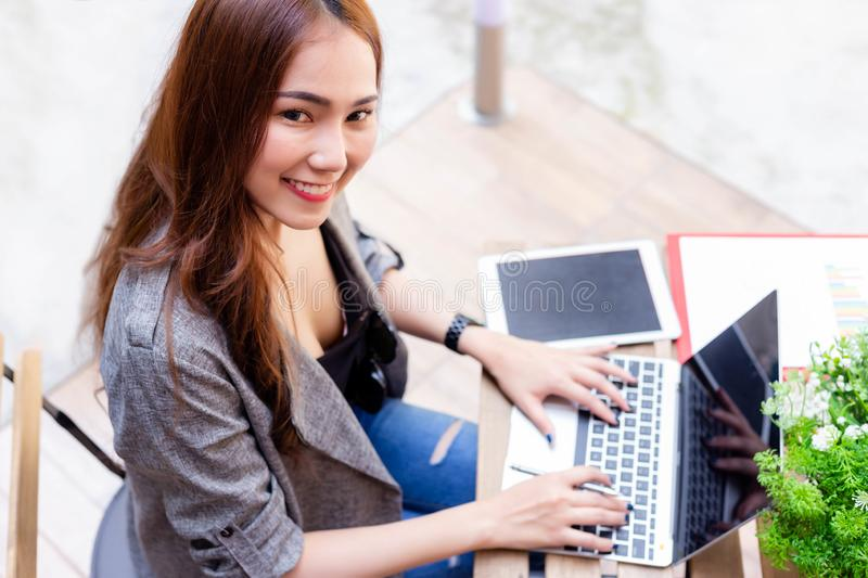 Attractive beautiful businesswoman get enjoying life because charming beautiful young woman can do her work everywhere by using l. Aptop computer, online stock photography