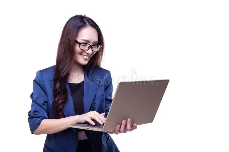 Attractive beautiful businesswoman is working on laptop. Charmin royalty free stock image