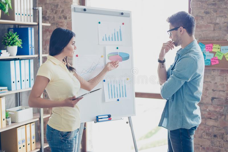 Attractive, beautiful woman presenting a new project to her business partner in work shop, goal setting, problem solving stock image