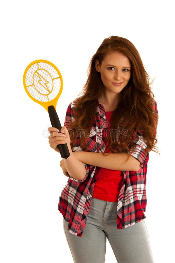 Attractive Beautiful young woman holds electric racket for kiling flies . royalty free stock photo