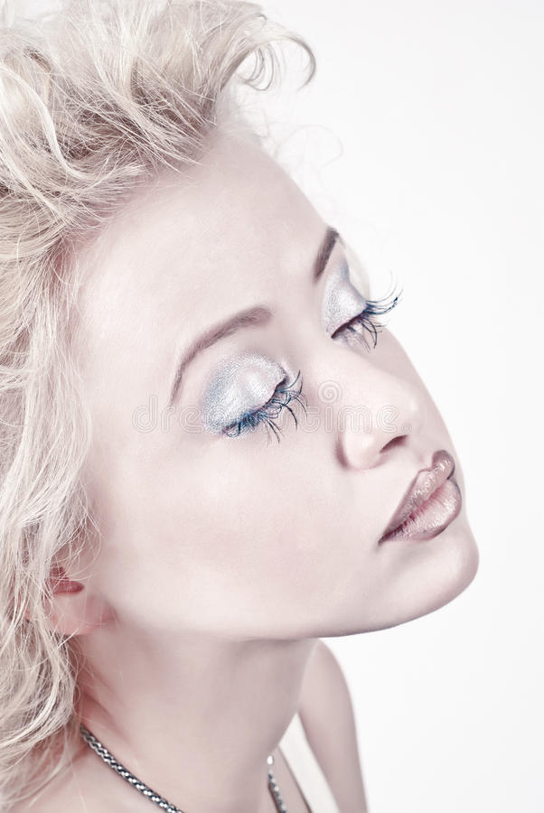 Attractive blond beauty portrait with closed eyes stock photos