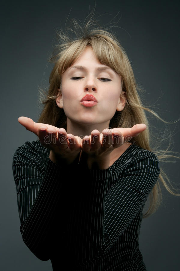 Download Attractive Blond Is Blowing A Kiss Stock Photo - Image: 11110752