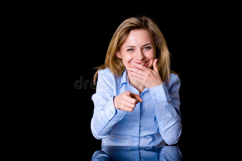 Attractive blond female laugh and point forward. Attractive young female laugh and point forward with her finger at the same time, studio shoot isolated on white stock photos