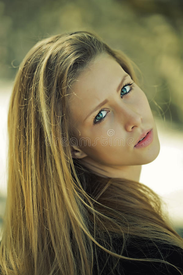 Attractive blond girl looking backwards royalty free stock photo