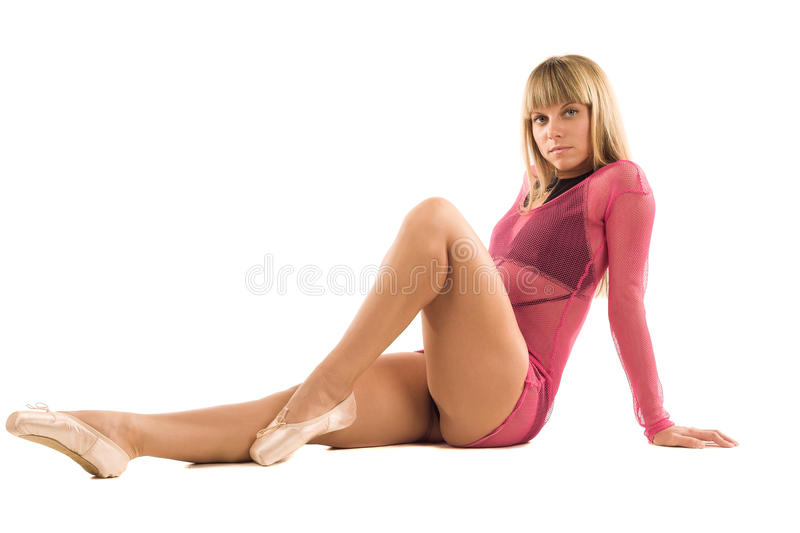 Attractive blond girl in pink dress royalty free stock photo