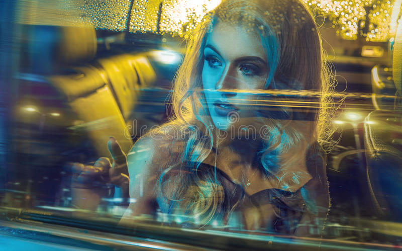 Attractive blond lady driving an elegant car royalty free stock photos