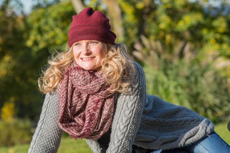 Attractive blond woman in an autumnal park stock photo