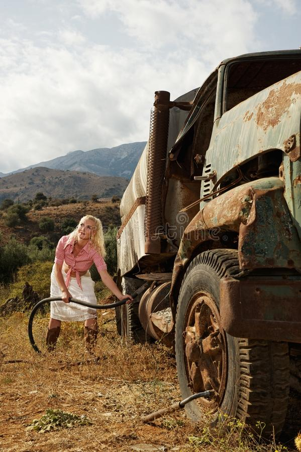 Download Attractive Blond Woman Filling Gas Tank Stock Image - Image: 19776875