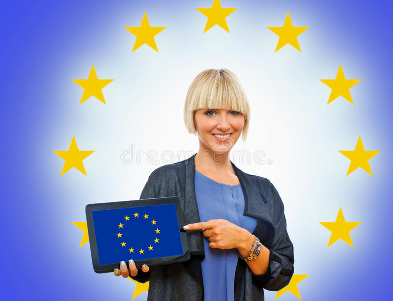 Attractive Blond Woman Holding Tablet With Europe Flag Stock Photography