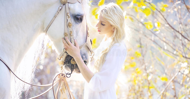 Download Attractive Blonde Cutie Touching Royal Horse Stock Photo - Image: 35324386