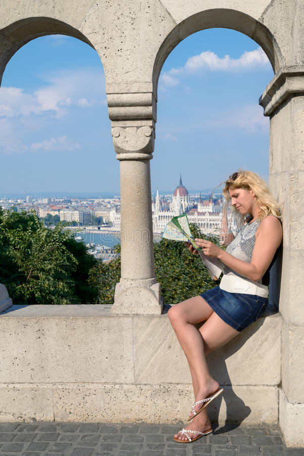 Attractive blonde female traveller with tourist map in centrall stock photo