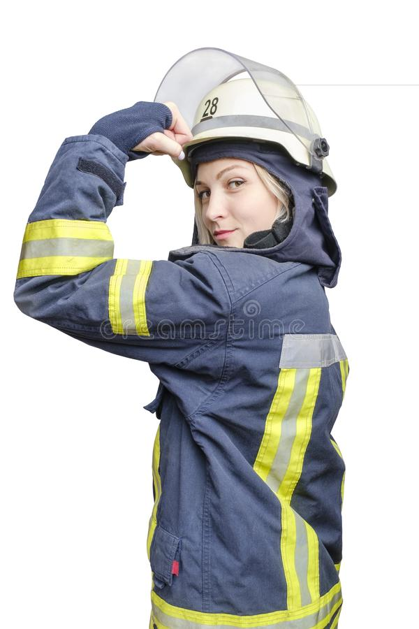 Attractive blonde girl-firefighter in helmet showing fist as woman power symbol royalty free stock photo