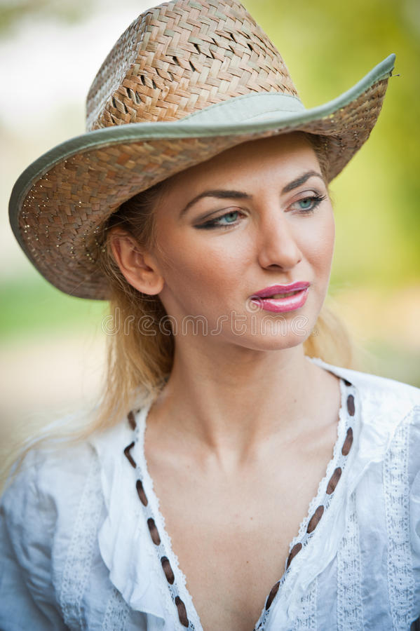 Download Attractive Blonde Girl With Straw Hat And White Blouse Royalty Free Stock Photography - Image: 30866837