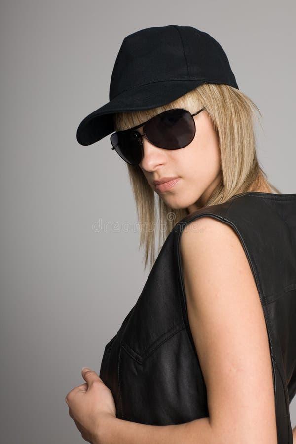 Attractive blonde girl in a sunglasses stock photo