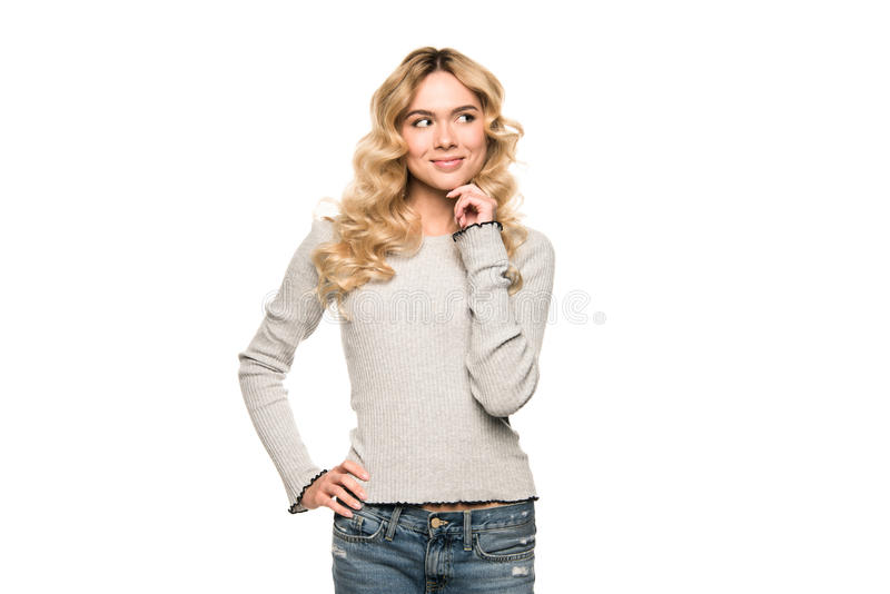 Attractive blonde thoughtful woman posing in casual clothes, royalty free stock photos
