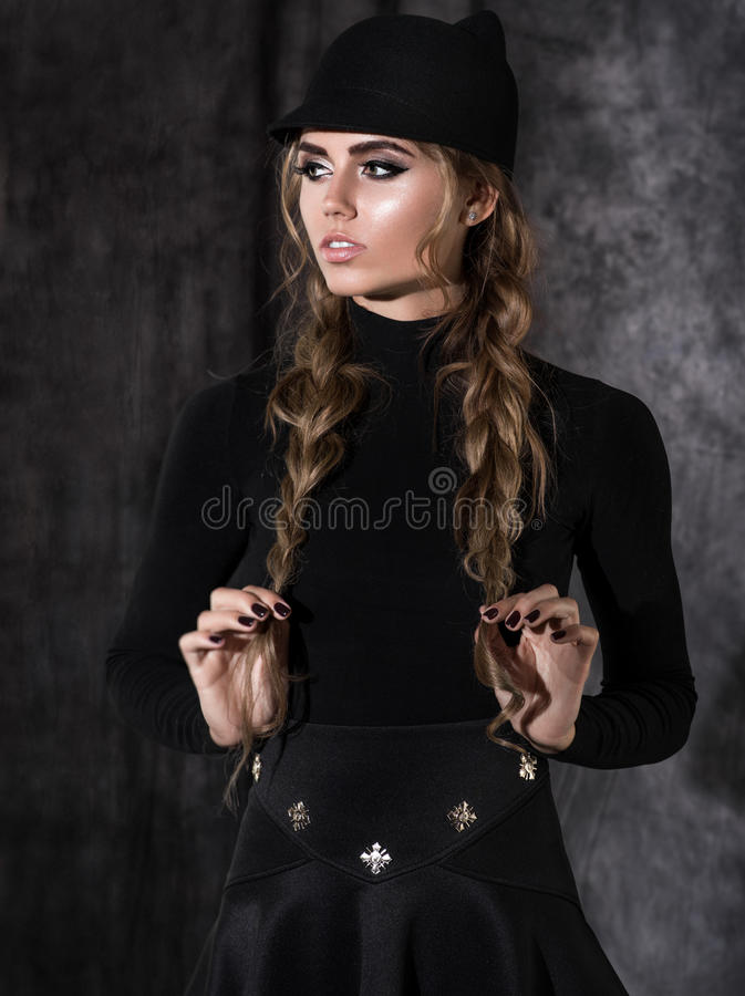 Attractive blonde woman in black dress royalty free stock photography