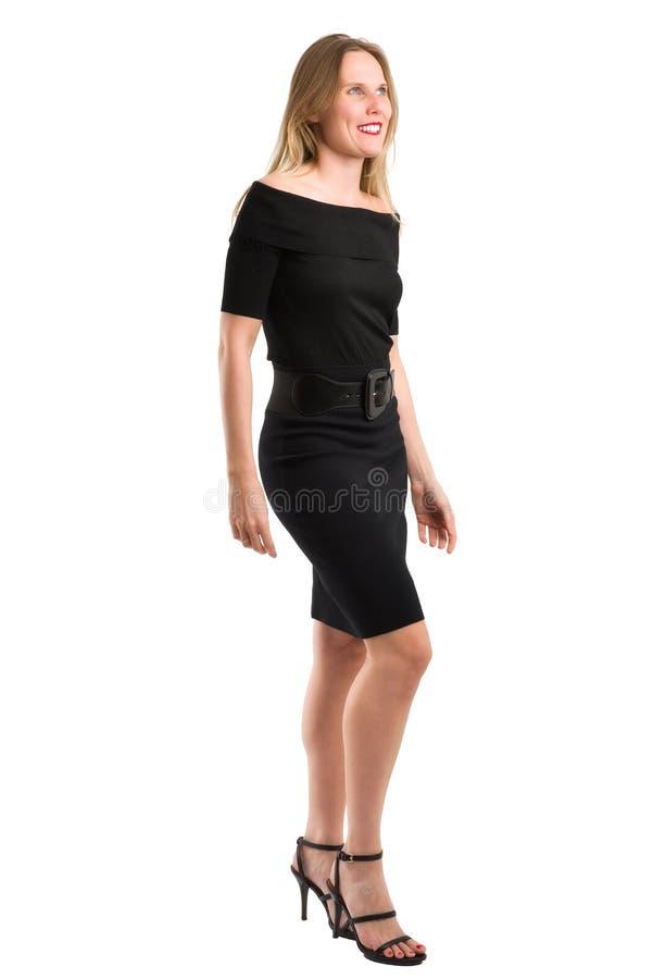 Blonde Woman In Blue Dress Showing Her Long Legs Stock