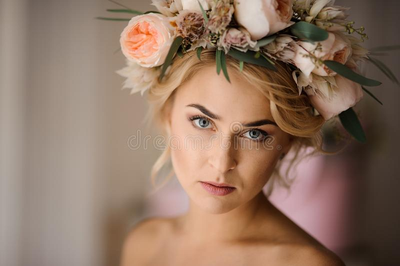 Attractive blonde woman in a floral wreath stock photo
