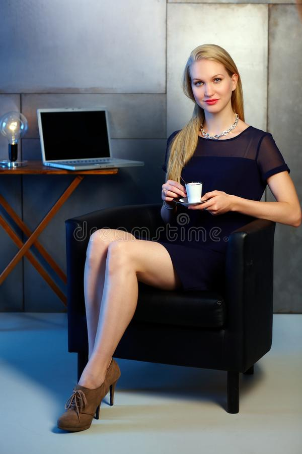 Attractive blonde woman holding coffee cup stock photos