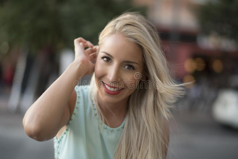 Attractive blonde woman looking at camera royalty free stock photo