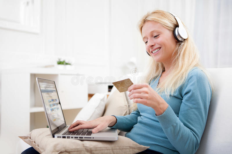 Attractive blonde woman shopping online. View of an Attractive blonde woman shopping online stock images
