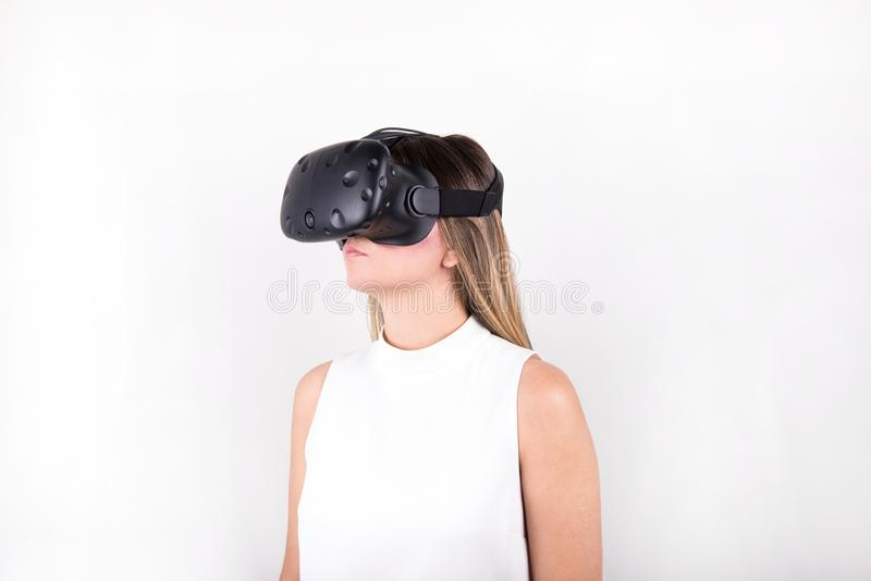 Attractive, blonde, young woman wearing virtual reality headset royalty free stock photo