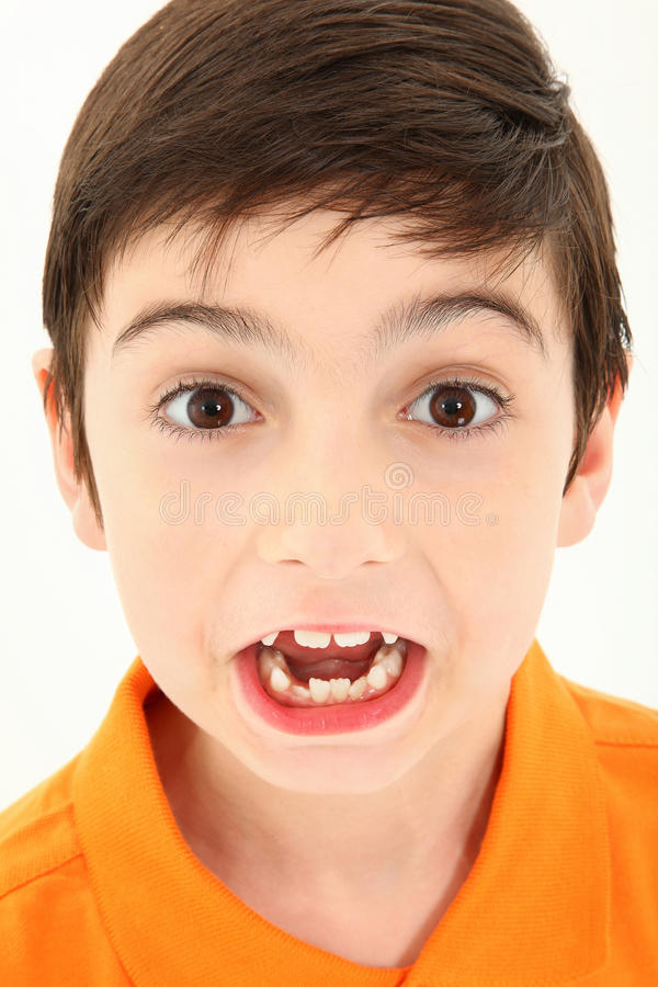 Attractive Boy Making Silly Face. Attractive 8 year old boy close up making silly face royalty free stock photos